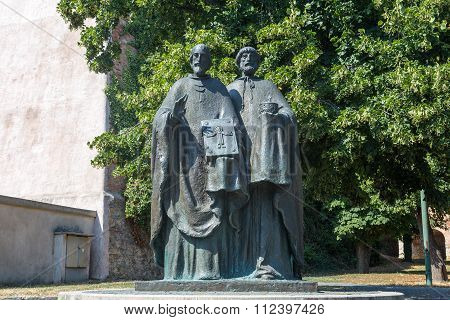 Sculpture Of Saints Cyril And Methodius On The Pope John Paul Ii Square At The Nitra Castle.