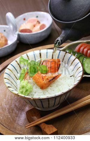 ochazuke is a simple japanese light meal made by pouring green tea over cooked rice. the toppings are salmon, tarako(pollock roe), umeboshi(pickled plum) and wasabi.