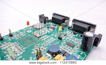 Serial Port And Green Pcb Circuit With White Background