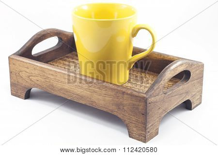Yellow Mug On Wooden Tray Isolated On White Background