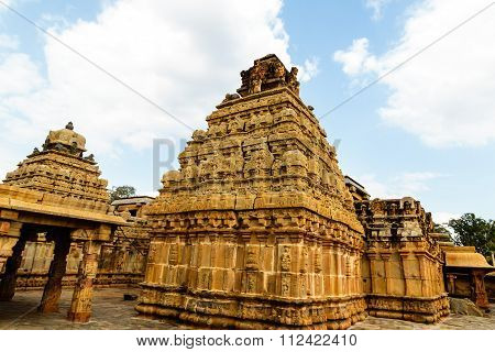 Richly carved walls and gopuram / pillars / towers of Ancient Hindu temple