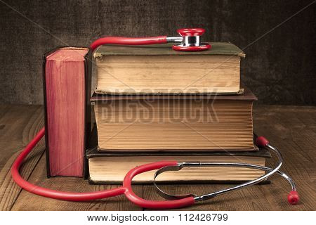 Red Stethoscope On Books