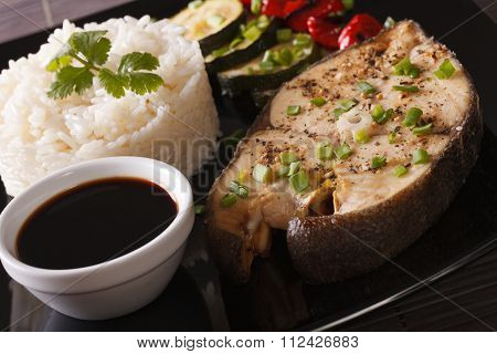 Baked Steak Of Fish And Rice On A Plate Close-up. Horizontal