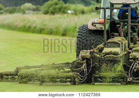 Tractor With Grass Cutter Mowing Lawn
