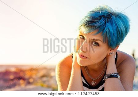 A Portrait Of Beautiful Girl With Blue Hair In Sailor's Striped Top