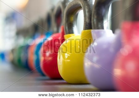 colorful kettlebell lining on table