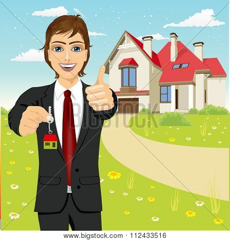 real estate agent holding the key of a new house