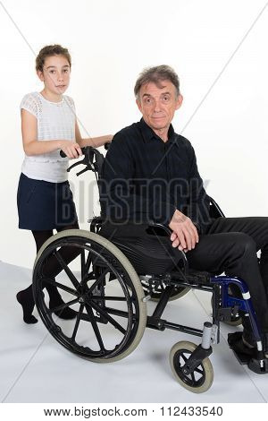 Girl Pushing Man In A Wheelchair - Father Or Grand Father