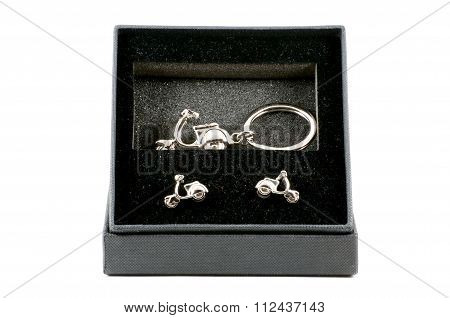 Isolated Set Of Motorbike Keychain And Cufflinks