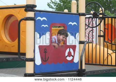 Young Boy At Playground With Boat