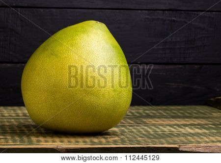 Fruit Of A Pummelo On An Wooden Table