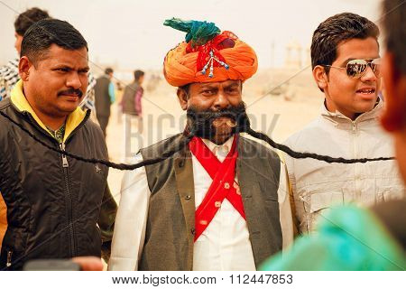 Senior Man In Traditional Rajasthan Dress Show The Great Mustaches During The Desert Festival In Ind