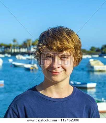 Handsome Happy Smiling Boy Witha Harbor In Background