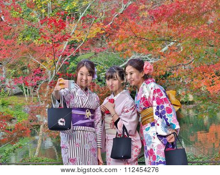 young Japanese women wear a traditional dress taking selfie by mobile phone