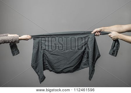 Man And Woman Hungrily Snatch Each Other's Hand Clothes At The Time Of Sale