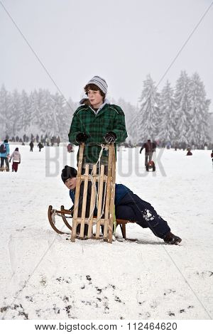 Children Are Skating At A Toboggan Run
