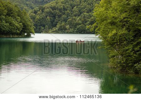 Lake Surrounded By Green Mountains