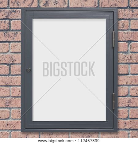 Empty shop window display on red brick wall background