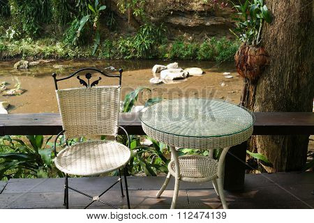 White Rattan Wicker Chair And Table On The Terrace
