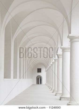 White Colonnade With White Columns And Door And Window