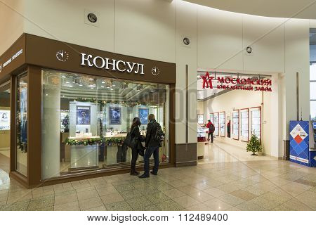 Khimki, Russia - December 22, 2015. The buyer at the shop window in  mall Mega croup