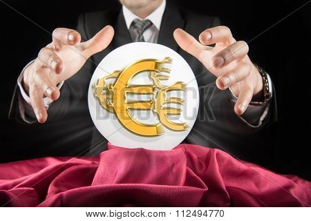 Fortune teller businessman, sees Euro sign in a crystal ball