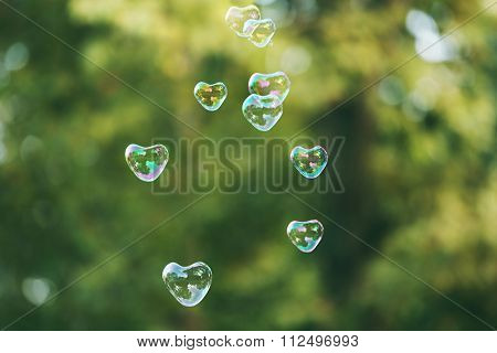 Soap bubbles in heart shape outdoor