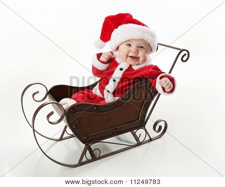 Smilng Santa Baby Sitting In A Sleigh