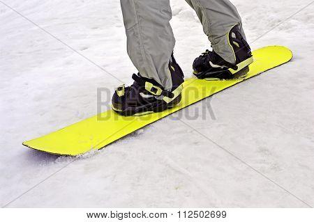 Sportsman With Yellow Snowboard On White Snow, Seasonal Sport