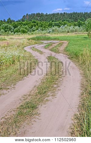 ground zigzag road in the meadow blue sky with white clouds, travel diversity