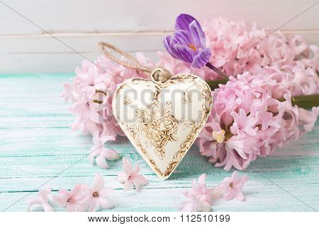 Background  With Fresh Flowers Hyacinths, Crocus  And Decorative Heart On Turquiose Painted Wooden P