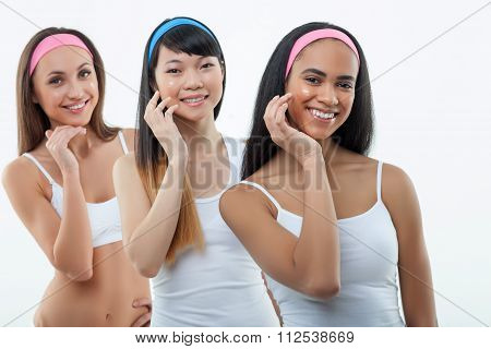 Attractive healthy three girls with international beauty