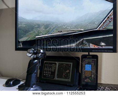 Hand on joystick, playing flight simulator