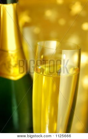 Flute Glass And A Bottle Of Champagne