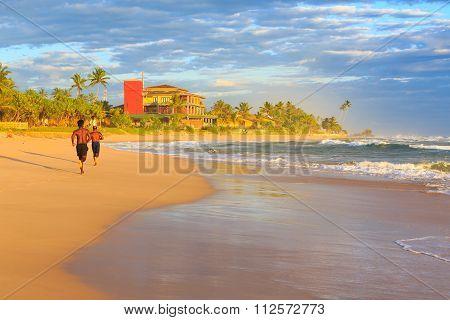 Men Running On The Beach At Sunset