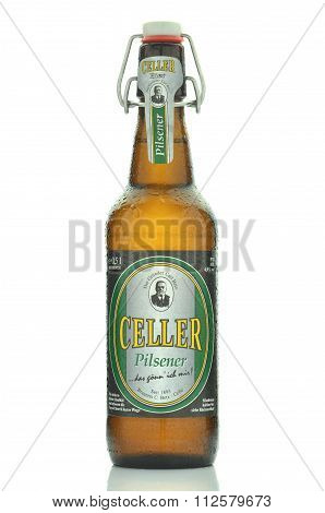 Celler pilsener beer isolated on white background.