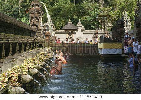 Bali, Indonesia, September 09, 2014 : Balinese People Praying At Holy Spring Water At Pura Tirtha.