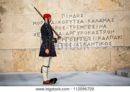 ATHENS, GREECE - CIRCA APR, 2015: Evzone guarding the Tomb of Unknown Soldier in Athens dressed in service uniform, refers to the members of the Presidential Guard, an elite ceremonial unit.