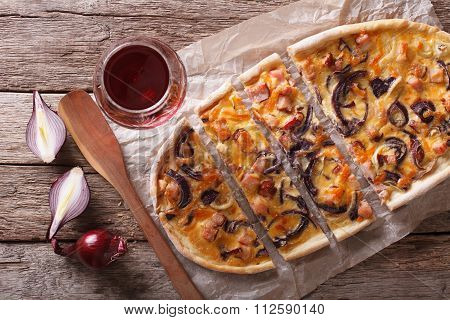 Sliced  Tarte Flambee And Red Wine Close-up. Horizontal Top View