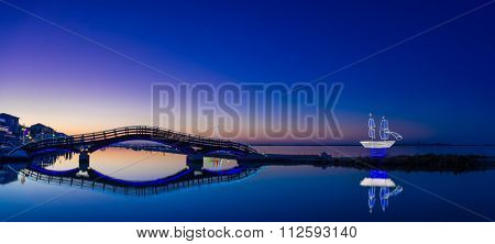 Bridge on the Ionian island of Lefkas Greece at sunset with Christmas decorations