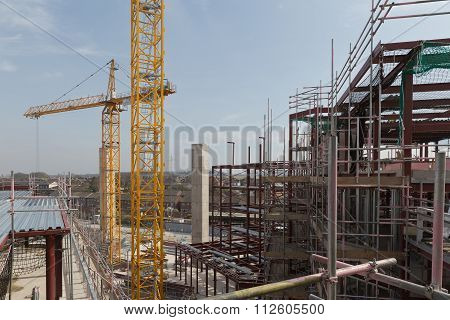 A Construction Site With Concrete Slabs Built Held Together With Scaffolding