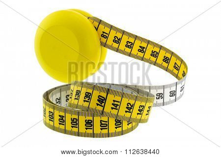 A wooden yellow YoYo with yellow measuring tape, isolated on white represent the idea of Yo-Yo dieting Effect