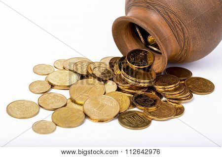 coins strewed from a pot