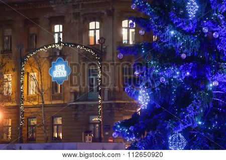 Close up of a decorated Christmas tree on city skating rink at Advent time in King Tomislav Park in Zagreb Croatia. Zagreb has been declared the best european christmas destination in 2015. poster