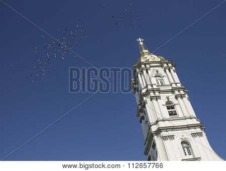Facade Of The Church And Birds In Ukrainian City Pochaiv