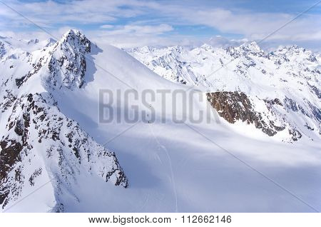Skiers On The Glacier In Alps