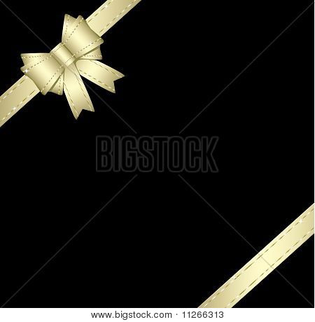 Golden Gift Ribbon And Bow Isolated On Black