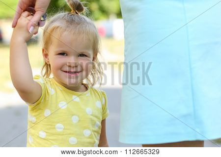 Smiling Funny Little Girl Outdoor Holding Mother Hand Portrait