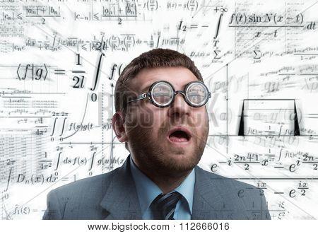 Professor in glasses thinking over math formulas