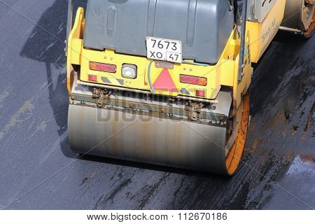 Road Vehicle Compacted Asphalt.